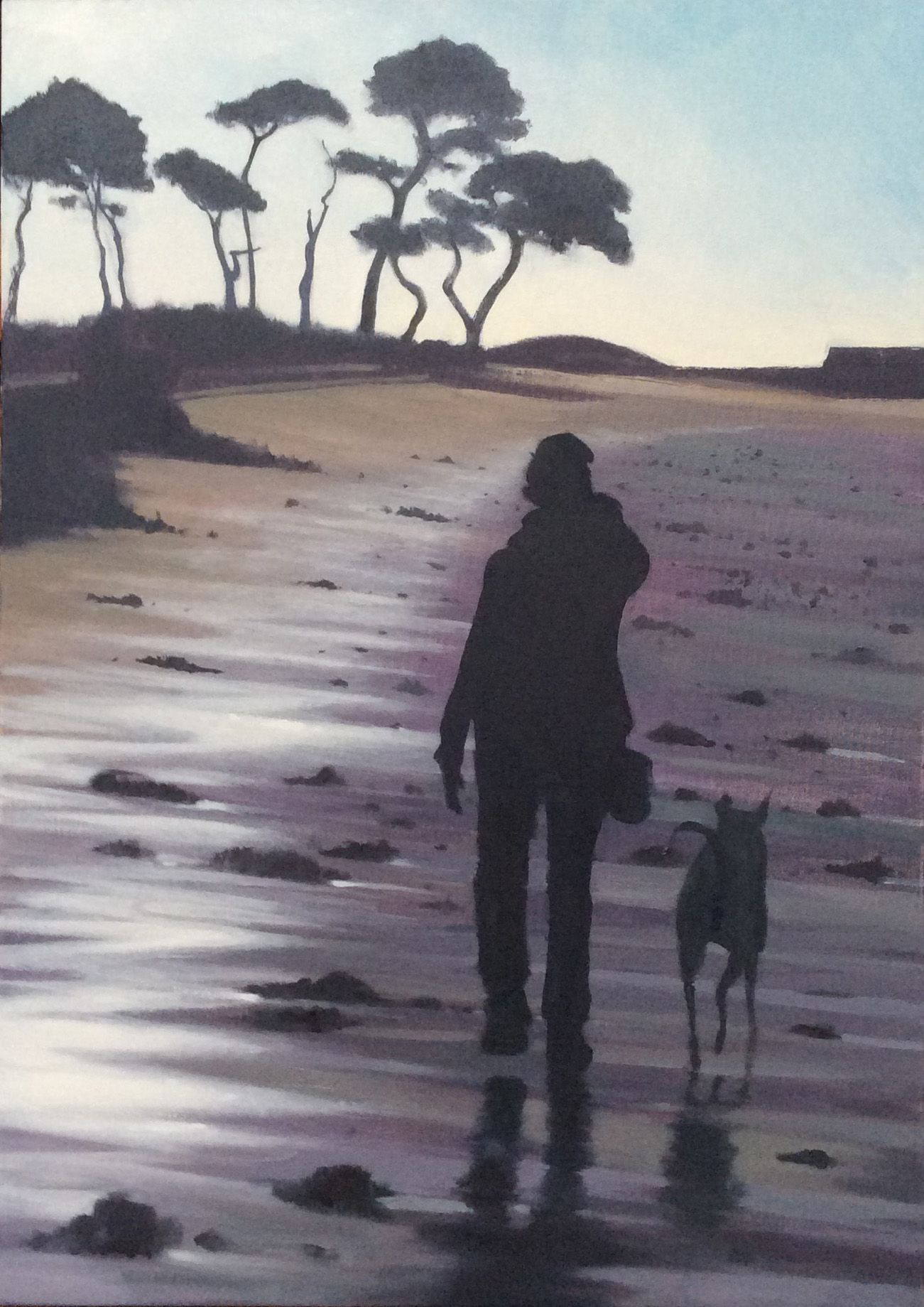 Figure walking on Brittany Beach with dog